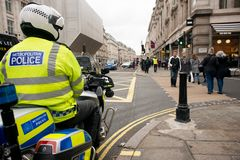 Metropolitan Police motorcycle riders escort a protest demonstration in central London, England. London, UK. 12th January 2019. Metropolitan Police motorcycle stock images