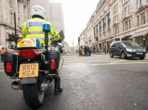 Metropolitan Police motorcycle riders escort a protest demonstration in central London, England. London, UK. 12th January 2019. Metropolitan Police motorcycle royalty free stock photos