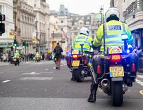 Metropolitan Police motorcycle riders escort a protest demonstration in central London, England. London, UK. 12th January 2019. Metropolitan Police motorcycle royalty free stock image