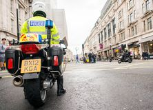 Metropolitan Police motorcycle riders escort a protest demonstration in central London, England. London, UK. 12th January 2019. Metropolitan Police motorcycle royalty free stock images