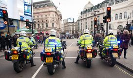 Metropolitan Police motorcycle riders escort a protest demonstration in central London, England. London, UK. 12th January 2019. Metropolitan Police motorcycle royalty free stock photo