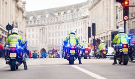 Metropolitan Police motorcycle riders escort a protest demonstration in central London, England. London, UK. 12th January 2019. Metropolitan Police motorcycle stock photos