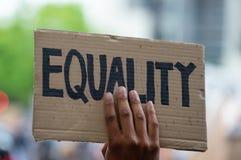 Protesters holding sign at Black Lives Matter protest demonstration in London.