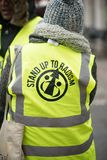 March Against Racism National Demonstration - London - United Kingdom. London, UK. 17th March 2018. EDITORIAL - Marshal wearing reflective vest at the March stock photos