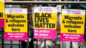 March Against Racism National Demonstration - London - United Kingdom. London, UK. 17th March 2018. EDITORIAL - Three posters attached to railings at the March stock photos