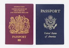 London, UK - 28th May 2019 - British and US passports, isolated on a white background stock image