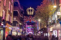LONDON, UK - 11TH NOVEMBER 2018: Carnaby Street Christmas decorations in 2018. In a Bohemian Rhapsody theme. Lots of people can be stock images