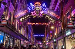 LONDON, UK - 11TH NOVEMBER 2018: Carnaby Street Christmas decorations in 2018. In a Bohemian Rhapsody theme. Lots of people can be stock image
