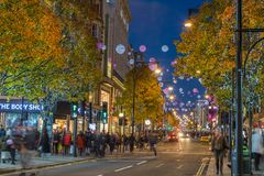 LONDON, UK - 11TH NOVEMBER 2018: Views along Oxford Street with colourful Christmas decorations and lights. Lots of people can be stock images