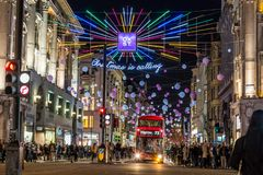 LONDON, UK - 11TH NOVEMBER 2018: Views along Oxford Street with colourful Christmas decorations and lights. Lots of people can be royalty free stock photo
