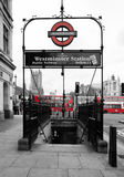 London underground. Westminster underground tube station entrance in London. Famous red buses on the background. Picture taken 25th April, 2012 Royalty Free Stock Image