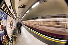 London Underground. Inside view of London Underground, oldest underground railway in the world, covering 402 km of tracks, on May 24, 2012 in London, UK Royalty Free Stock Photography