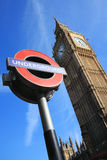 London Underground and Big Ben. London, UK - Apr 9, 2011: London Underground sign at Westminster tube station with Big Ben in the background Royalty Free Stock Image