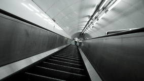 London Underground escalator. An abstract, low and wide angle view up the escalators deep within the London Underground transport network Royalty Free Stock Image