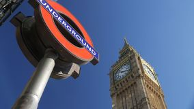 London Underground logo with Big Ben behind. Tilt shot of the London Underground logo with Big Ben behind. Shot on a sunny September afternoon in 4K stock video footage