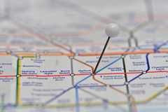 London Underground Map with pin in Oxford Circus Station. Used London Underground Map showing some of the train lines that go across the capital. Focus on The Stock Photo