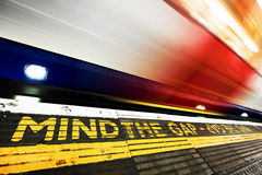 London underground. Mind the gap sign, train in motion. London underground, tube. Mind the gap sign painted on the floor. Train speeding in motion Stock Photos