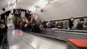 London Underground. People travelling on escalator in London Underground stock video