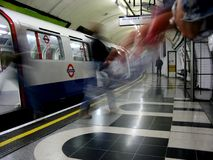 London Underground platform. Motion blur, long exposure. Embarking passengers Stock Photo