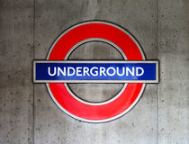 London underground sign. On a concrete wall Royalty Free Stock Image
