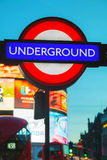 London underground sign. LONDON - APRIL 12: London underground sign at the Piccadilly Circus station on April 12, 2015 in London, UK. It's a road junction and Royalty Free Stock Photo