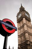 London underground sign and Big Ben. In background Royalty Free Stock Image