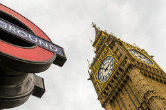 London Underground Sign and Big Ben. Famous London underground tube sign and Big Ben landmark with nobody Stock Photo