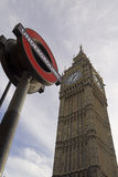 London Underground Sign and Big Ben. LONDON - JANUARY 17: The Big Ben. The London 'Underground' logo will be used for other transportation systems - has been Stock Image