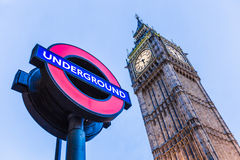 London underground sign in front of Big Ben. At Westminster Stock Photo