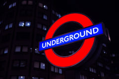 London Underground sign light at night. The famous London Underground sign Stock Photos