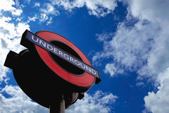 London underground sign over blue sky Stock Images