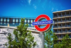 London Underground sign. Vibrant colourful image of an underground tube station sign outside of London's Kings cross station Royalty Free Stock Image