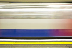 London underground. Station with moving train Royalty Free Stock Image