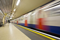 London underground. Station with moving train Stock Photo