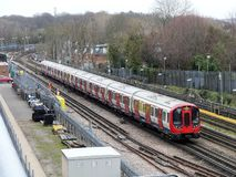 London Underground train passing by on track in Rickmansworth stock photography