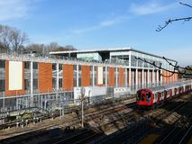 London Underground train passing Waitrose supermarket store in Rickmansworth royalty free stock image