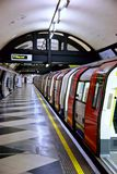 London underground Tube. A view of a London subway or Tube train stopped at the platform of an underground station Stock Image