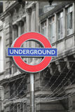 London Underground tube sign. A London Underground / tube sign , isolated against a gray building background Stock Image