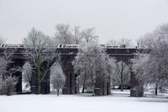 London underground tube train on bridge. Above snow covered park, January 2010 Stock Photo