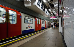London Underground Tube. Train departing from the station of the London Underground Stock Photo