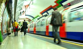 London underground. LONDON, UK - JULY 9, 2014: High speed train leaves the Piccadilly underground station in London Stock Images