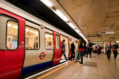London Underground. LONDON, UK - MAY 12 2015:Passengers on London Underground platform. The Annual passenger numbers of london Underground Stock Image