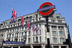 London Underground and Union Flags. London Underground sign and Union Flags at Oxford Circus station Royalty Free Stock Photography