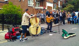 Musical group playing on the street royalty free stock photography