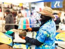London, United Kingdom - April 4, 2015. Coconut seller at Portob Stock Photography