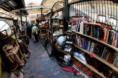 London, United Kingdom - April 01, 2007: Extreme wide angle - fisheye - photo. Stalls with various used stuff, mostly books,