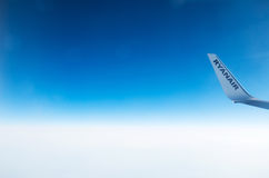 LONDON, UNITED KINGDOM - April 12, 2015: Ryanair logo on airplane's wing tip in mid-air over United Kingdom Stock Photography