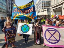 London, United Kingdom, April 15th 2019:- Extinction Rebellion protesters block in Oxford Circus in central London. To protest the current environmental royalty free stock photography