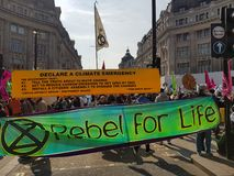 London, United Kingdom, April 15th 2019:- Extinction Rebellion protesters block in Oxford Circus in central London. To protest the current environmental stock photo