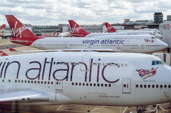 LONDON, UNITED KINGDOM - April 10, 2015: Virgin Atlantic Boeing B747 airplanes parked at Gatwick Airport Stock Image
